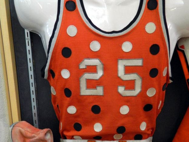 Coach Bill Brimm designed Madison's basketball uniforms, which featured 168 polka dots on each one.