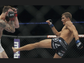 Johnny Bedford (red gloves) fights Cody Gibson (blue gloves) in a Bantamweight bout at UFC Fight Night 44 on Saturday at the AT&T Centerin San Antonio, Texas.