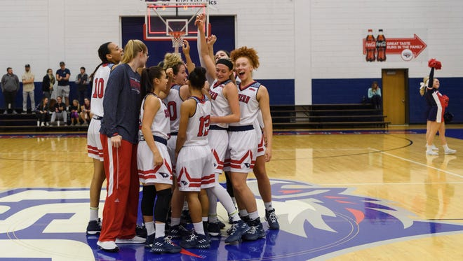 The USI Screaming Eagles huddle together as they celebrate their win over the Lewis University Flyers at USI's Physical Activities Center in Evansville, Ind., Thursday, Nov. 30, 2017. The Screaming Eagles defeated the Flyers, 67-56.