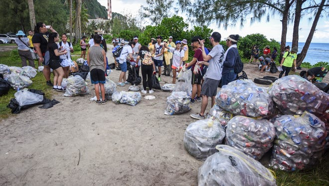 High school students, parents and other volunteers sort through trash collected during the 23rd Annual Guam International Coastal Cleanup 2017 at Tanguisson Beach on Saturday, Sept. 16, 2017.