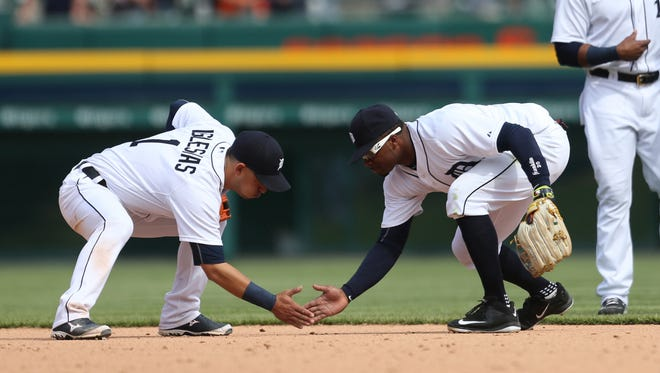 Tigers shortstop Jose Iglesais and rightfielder Rajai Davis celebrate after Thursday's win at Comerica Park.