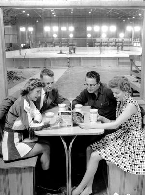 Relaxing in the Fairgrounds Arena Building ice rink's concession hall on 13 April, 1955 are Sara Jo Bolt (Left) Ice Carnival star, and Barbara Mann of Collierville, a Goldsmith's model all set to try out her new blades on the Mid-South's first ice skating rink.  Behind them are Kemmons Wilson (Left), Iceland president and John Reid, general manager of the rink.