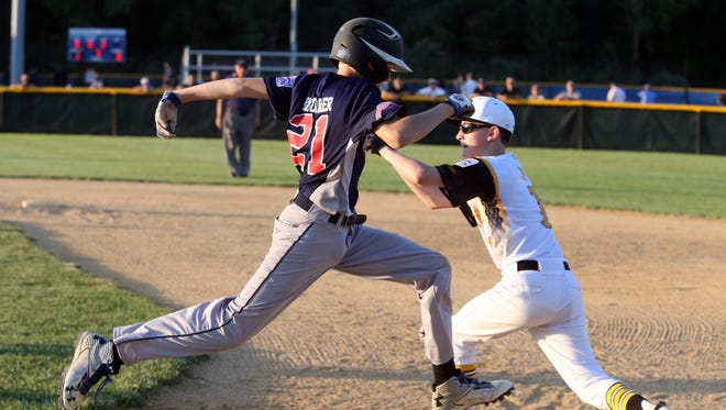Bordentown takes on North Howell in the Little League Section 3 elimination tournament held at Michael J. Tighe Park in Freehold Township on Tuesday July 19, 2016.North Howell's # 21 Dillion Knuecker leaps toward first base to try and beat the throw.