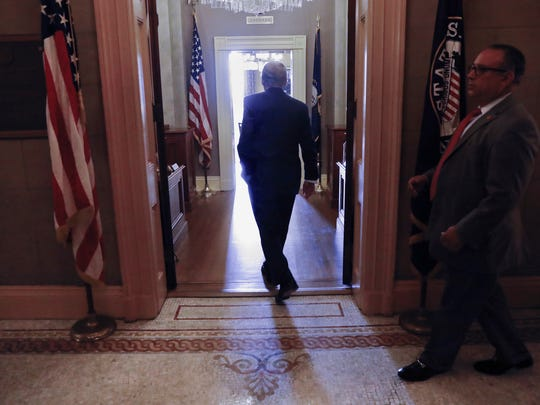 Senate Majority Leader Mitch McConnell of Ky. walks into his office on Capitol Hill in Washington Thursday, July 13, 2017. McConnell is planning on rolling out the GOP's revised health care bill, pushing toward a showdown vote next week with opposition within the Republican ranks.