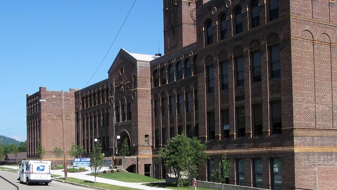The former Corning Free Academy Middle School was converted into upscale apartments in 2015.
