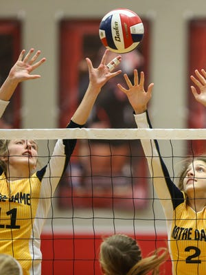 Notre Dame's Natalie Hardig and Abby Noll go for a block against St. Henry during their Ninth Region championship match at Dixie Heights, Thursday, October 27, 2016.