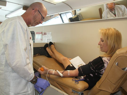 Jeannie Watson donated blood in the Carlsbad Chamber of Commerce's parking lot on Thursday afternoon.