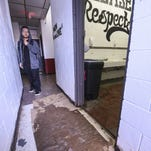 Cardboard boxes absorb bathroom runoff and leaking rainwater at Simon Sanchez High School in Yigo on Oct. 1.
