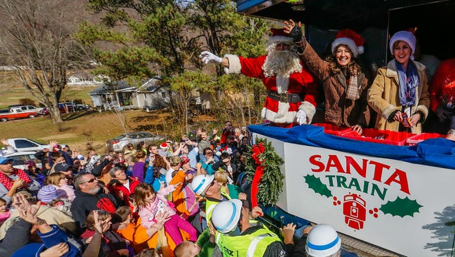 "Standing at St. Nick's side, Nashville singer-songwriter Amy Grant (""Tennessee Christmas"") served as celebrity guest on Saturday's 72nd annual Santa Train, an Appalachian holiday tradition that shares 15 tons of toys, dolls, candy and winter clothing to children in 14 communities in Kentucky, Virginia and Tennessee. The railway gift-giving event, sponsored by CSX, Dignity U Wear, Food City and the Kingsport (Tennessee) Chamber of Commerce, requires the efforts of 500 volunteers."