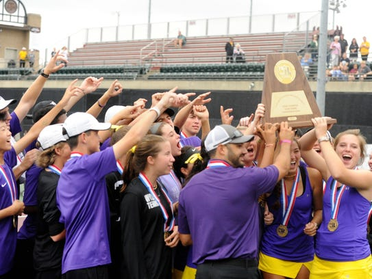 The Wylie tennis team celebrates winning the Class 4A state championship 10-0 against Fredericksburg this fall. Next year Wylie will be competing in Class 5A.