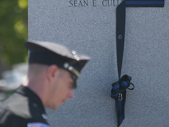 Fallen N.J. State Police Trooper Sean E. Cullen's name is shown on a monument during the Burlington County Fallen Officer Memorial Service at the Burlington County Police in Mount Holly.