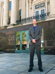 Chris May, library director at the Mansfield/Richland County Public Library, stands outside the main library at 43 W. Third St. in this News Journal file photo.