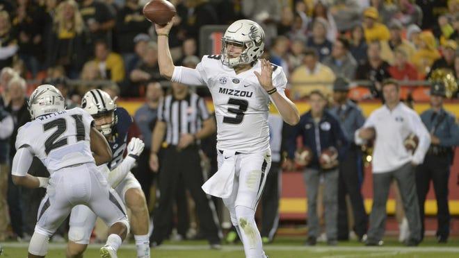 Missouri quarterback Drew Lock (3) throws a pass during the first half against BYU on Saturday at Arrowhead Stadium in Kansas City.