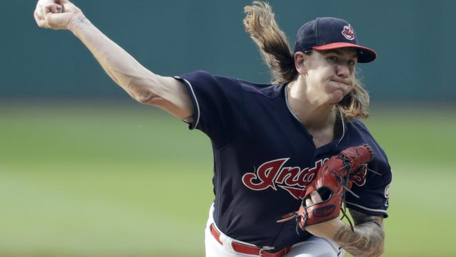 Indians starting pitcher Mike Clevinger delivers against the Chicago White Sox in 2018.