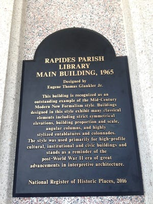 The Rapides Parish Main Library officials unveiled the building's National Register of Historic Places plaque on Tuesday.