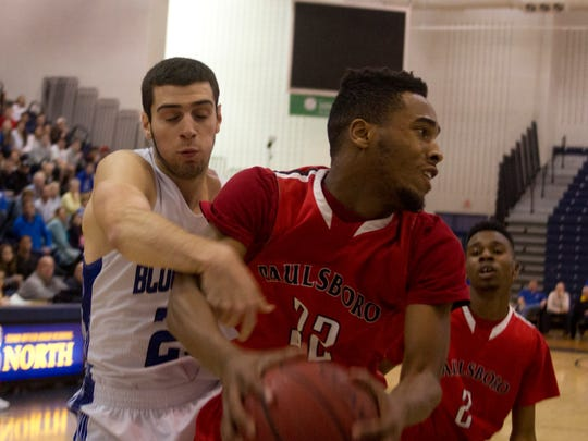 Paulsboro's Tyrique King pulls down a first-half rebound against Shore Regional.