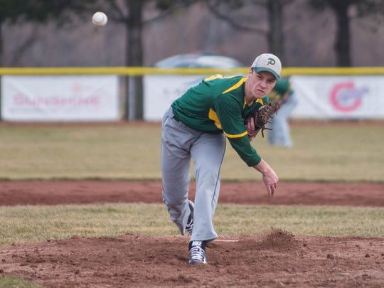 Pennfield's Jordan Hultink throws home against Lakeview during a recent game.