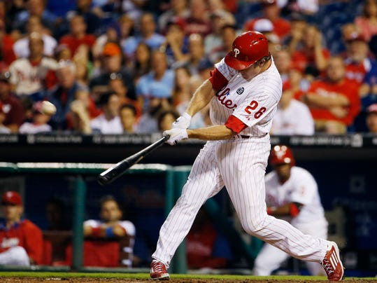 Philadelphia Phillies' Chase Utley hits a three-run home run off Houston Astros starting pitcher Brad Peacock during the fourth inning of an interleague baseball game, Wednesday, Aug. 6, 2014, in Philadelphia. (AP Photo/Matt Slocum)
