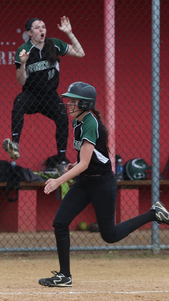 Yorktown's Sam Riccardulli (18) climbs the dugout fence while cheering on her teammates during the Section 1 Class AA championship at North Rockland High School on May 27, 2017.