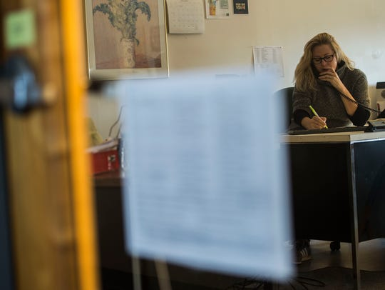 Julie Coffey answers hotlines calls at Steps to End