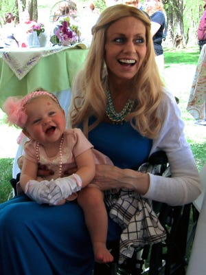 Athena Krueger with her daughter, Amari, at the girl's birthday party