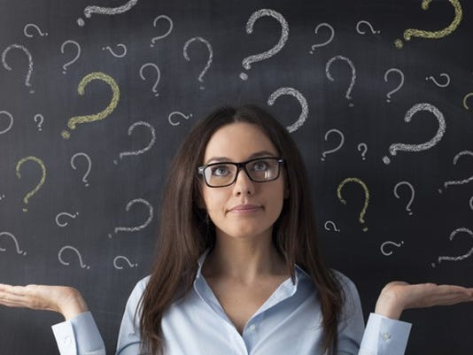 young_woman_question_marks_gettyimages-476562658_large.jpg