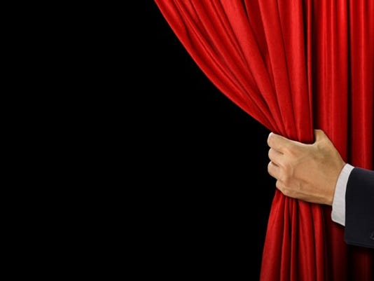 business-man-revealing-whats-behind-a-curtain-gettyimages-585624358_large.jpg