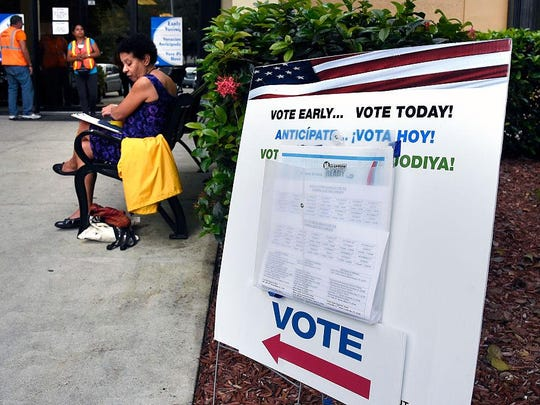 People line up to vote at an early voting polling centre in Miami, Florida on Nov. 3, 2016.