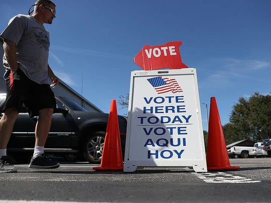 TAMPA, FL - OCTOBER 24: A voting sign points early voters to the polling station at the Hillsbourgh County Supervisor of Elections office on October 24, 2016 in St. Petersburg, Florida. Today early general election voting started in the state of Florida and ends on either Nov 5 or Nov 6th. (Photo by Joe Raedle/Getty Images)