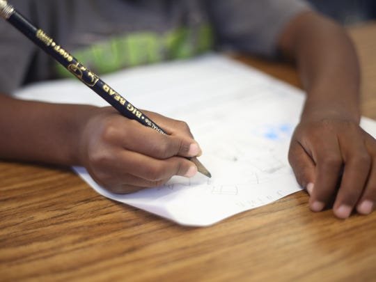 Vista Del Monte Elementary kindergarden student Jaivin Patrick practices holding a pencil properly in his class with Mr. Surrey Tribble on September 17, 2015.