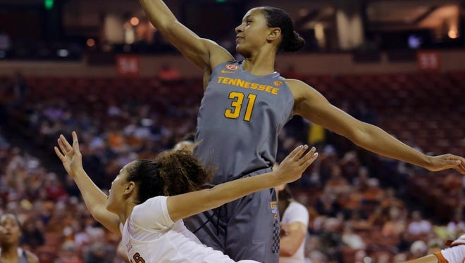 Tennessee's Jaime Nared blocks the shot of Texas  guard Brooke McCarty on Sunday at Frank Erwin Center.
