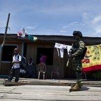 Colombian marines patrol in Buenaventura, Colombia, on March 25, 2014.