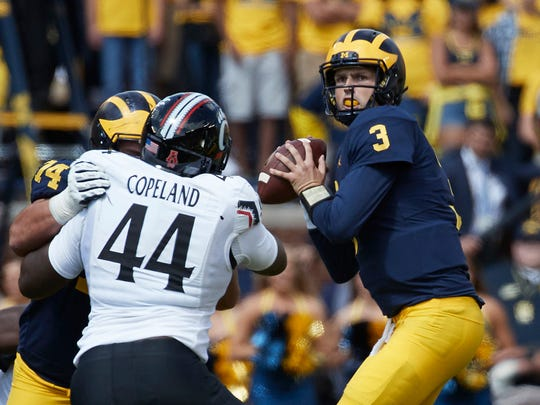 Sep 9, 2017; Ann Arbor, MI, USA; Michigan Wolverines quarterback Wilton Speight passes in the first half against the Cincinnati Bearcats at Michigan Stadium.