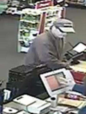This man is accused of holding an Evansville CVS employee at gunpoint while robbing the store. Anyone who can identify him is asked to call Evansville Police Department at 812-436-7979 or the anonymous WeTip hotline at 1-800-78-CRIME (1-800-782-7463).
