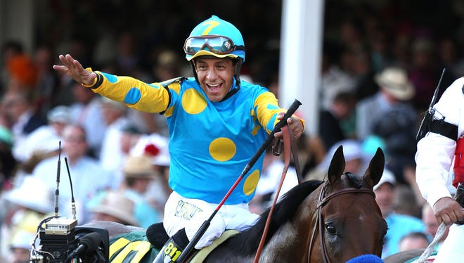Victor Espinoza, jockey of 'American Pharoah', celebrates after his third Kentucky Derby win.