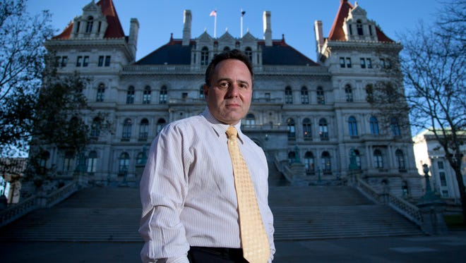 In this Nov. 23, 2015 photo, College of Saint Rose professor Bruce Roter, founder and president of the Museum of Political Corruption, poses outside the state Capitol in Albany, N.Y.