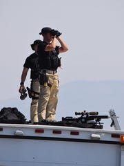 Officials prepare for President Barack Obama's arrival on Saturday, June 20, 2015, at Palm Springs International Airport.