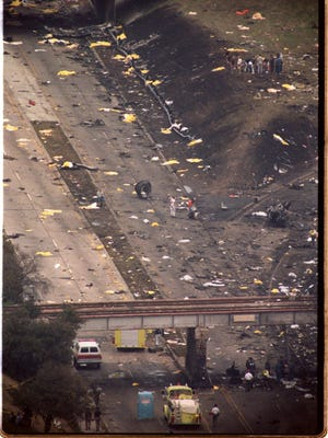 Aerial photograph shows the demolished remains of Northwest Airlines flight 255. The yellow body bags cover the remains of those who died in the crash Aug. 16, 1987. [WILLIAM DEKAY/DETROIT FREE PRESS]