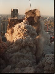 The historic Hudson's building is imploded along Woodward