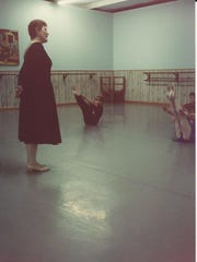 Marion Mills (left) teaches a class of young, aspiring ballet dancers, including student Kate Meehan Pedrotty (center) and her sister Frannie Meehan (far right).