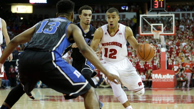 Wisconsin guard Traevon Jackson drives to the hoop during the second half against Duke.