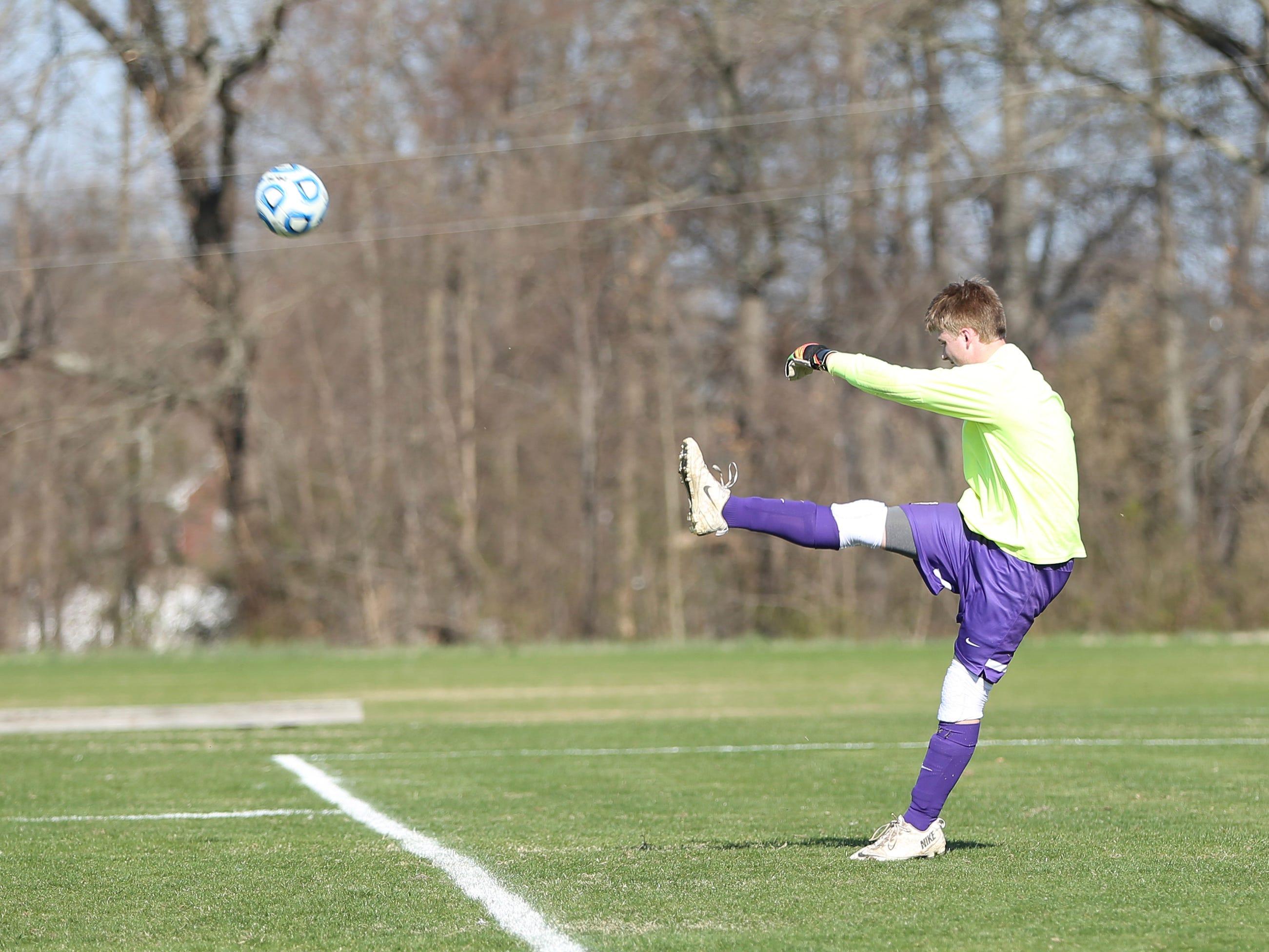 Trinity Christian Academy goalkeeper Kyle Akin punts the ball down the field.