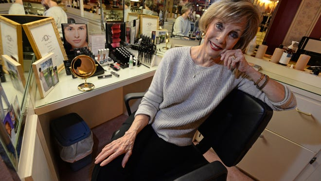Kitty Roark of Couleur Boutique helps her clients choose the proper make-up as a color analyst for the the women's boutique.