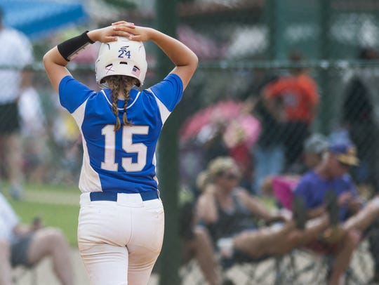 Marbury's Kenzie Bayer reacts to getting an out late