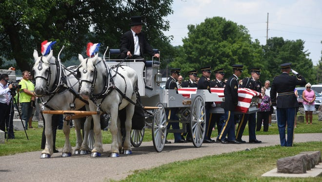 """The Army National Guard Funeral Honor Guard conveys the casket of Pvt. Eugene J. """"Gene"""" Appleby to his final resting place in South Lawn Cemetery on Thursday."""