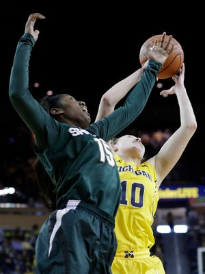 Michigan State forward Victoria Gaines knocks the ball away from Michigan guard Nicole Munger during the second half of MSU's 86-68 win Sunday, Feb. 19, 2017 in Ann Arbor.