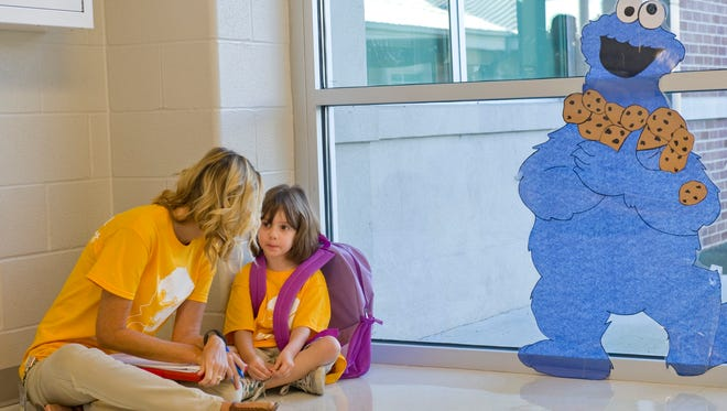 Emma Gilbert gets to know instructional assistant Shannon Sawyer at the Thelma B. Johnson Early Learning Center on the first day of school there Monday morning. For older students, the first day of school in Henderson County was Aug. 10.