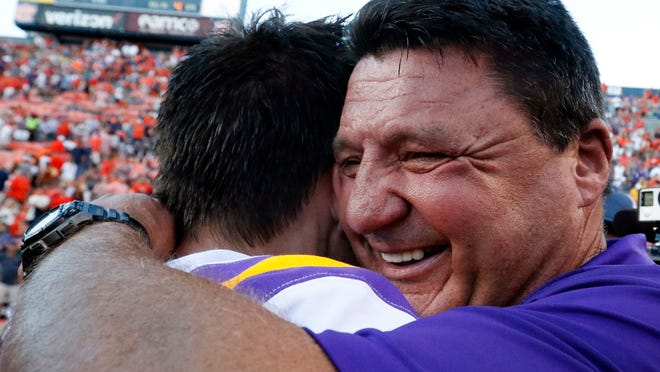 LSU head coach Ed Orgeron hugs place kicker Cole Tracy (36) after he kicked the winning field goal to defeat Auburn 22-21 during the second half of an NCAA college football game, Saturday, Sept. 15, 2018, in Auburn, Ala. (AP Photo/Butch Dill)