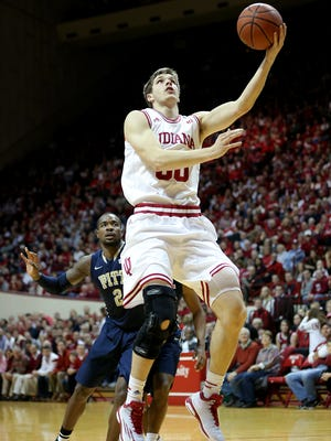 "Indiana could have to face Northwestern without reserve forward Collin Hartman (pictured) on Wednesday. The Cathedral alum's status is ""uncertain"" because of a bone bruise in his left leg."