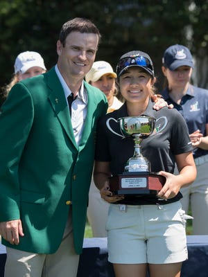 Zach Johnson poses with girls 14-15 champion Savannah Grewal during the Drive, Chip and Putt National Finals at Augusta National Golf Club on April 3.